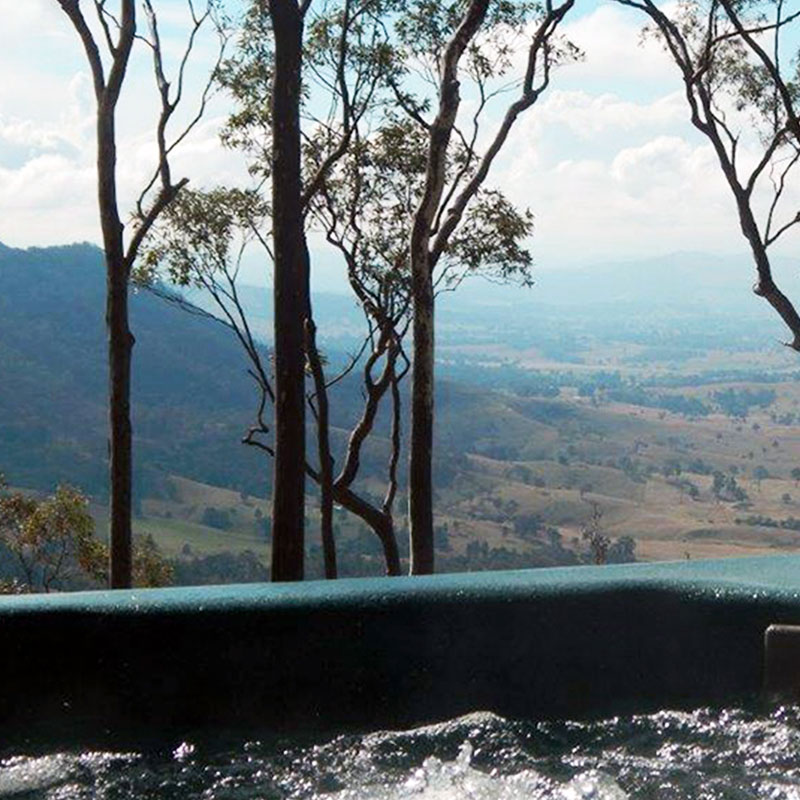 Spa with outlook to mountain range and valley at Kangaloo