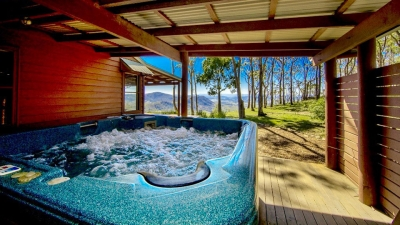 Spa at Bilby cabin looking out to trees and distant mountain range