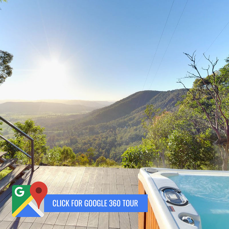 "Spa on deck at Peta cabinoverlooking valley with ""Click for Google 360"" call to action"
