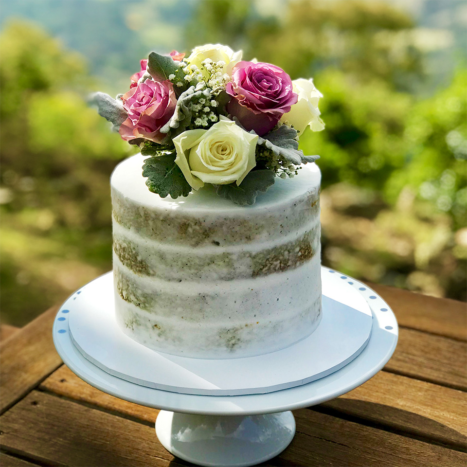 Rustic style cake with decorative flowers