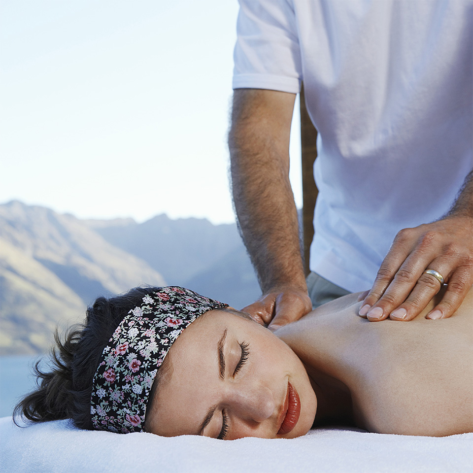 Woman getting massage with mountain range behind