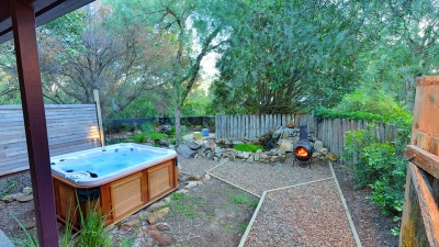 Spa and garden in front yard with chiminea